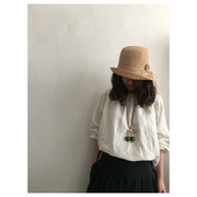 mature ha. raffia hat