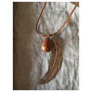 hand made necklace feather and egg